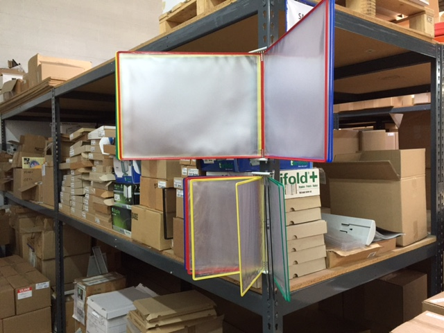 W291A3-LANDSCAPE TARIFOLD WALL ORGANIZER IN WAREHOUSE USE.