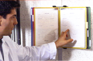 Man pointing to relevant data in his Tarifold wall mounted literature organizer.